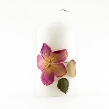Candle decorated with wild flowers